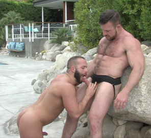 Luke Adams and Liam Knox trade positions in Muscle Daddies.